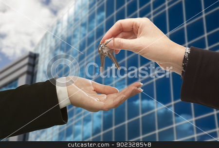 Female Handing Over the Keys in Front of Corporate Building stock photo, Female Handing Over the Keys to Other Woman in Front of Corporate Building. by Andy Dean