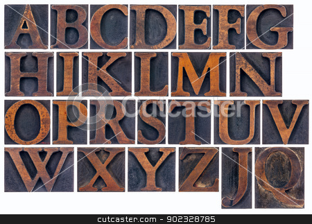 isolated alphabet in wood type stock photo, complete English alphabet  in vintage  wood type - a  collage of 26 isolated letterpress printing blocks stained by ink by Marek Uliasz