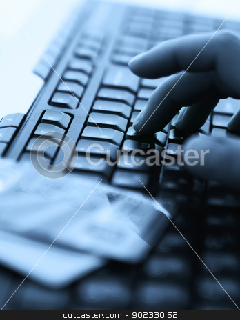 Credit cards and laptop stock photo, Tinted blue photo with computer keyboard, credit cards and hands by Olga Altunina