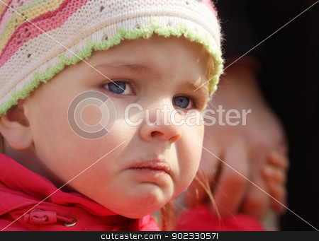 Offended girl closeup stock photo, Little pretty offended girl closeup on a walk with Dad by Olga Altunina