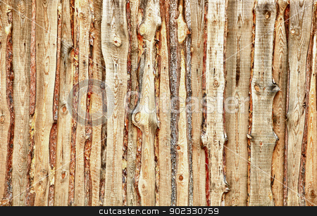 Wooden planks and slabs fense stock photo, A fence made of rough wooden planks and slabs by Alexey Romanov