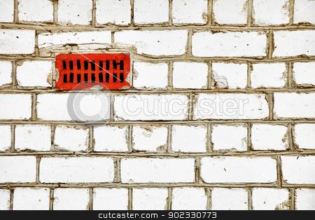 Improvised ventilation on primitive brick wall stock photo, Improvised ventilation in gray primitive brick wall by Alexey Romanov
