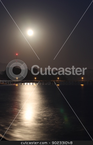 Full Moon Rise stock photo, Full moon rise over the Goleta pier. by Henrik Lehnerer