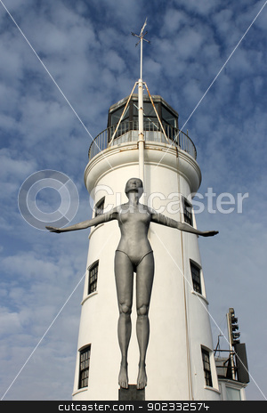 Scarborough Lighthouse stock photo, Scarborough Lighthouse with Diving Belle sculpture in foreground, England. by Martin Crowdy