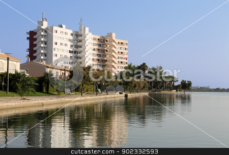 Spanish tourist hotel stock photo, Scenic view of Spanish tourist hotel by side of lake on island of Majorca, Spain. by Martin Crowdy