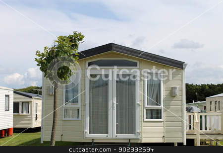 Static caravan in trailer park stock photo, Exterior of modern static caravan in trailer park, Cayton Bay, England. by Martin Crowdy