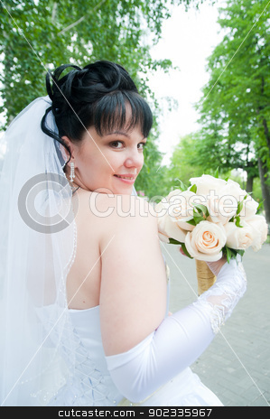 portrait of young happy bride... stock photo, Portrait Of Young Happy Bride With Flower Bouquet. by Aikon