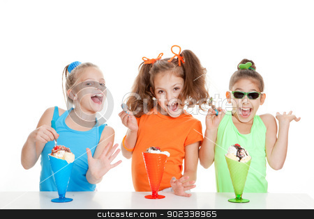 kids birthday party stock photo, happy kids eating icecream at birthday party by mandygodbehear