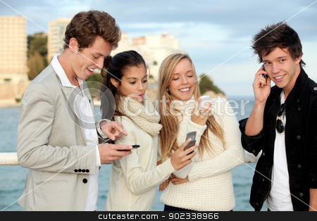 teens mobile or cell phones stock photo, teens talking or texting on mobile cell phones. by mandygodbehear
