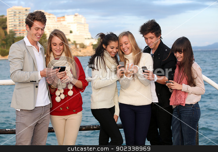 kids with mobile or cell phones stock photo, kids texting with mobile or cell phones by mandygodbehear
