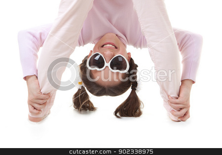upside down child stock photo, fun child smiling playing upside down by mandygodbehear