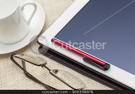 digital tablet computer stock photo, digital tablet computer with stylus pen, cup of coffee and reading glasses by Marek Uliasz