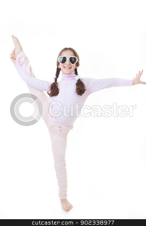 child dancing or exercising stock photo, Happy smiling child gymnast exercising or dancing by mandygodbehear