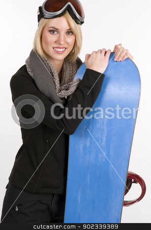 Snow Ready Female Holds Her Snow Board stock photo, A Beautiful Blonde Woman poses with her Snowboard by Christopher Boswell