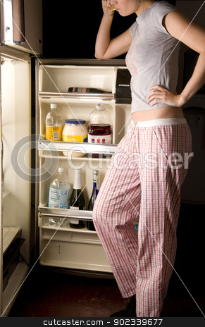 Snack in Pajamas Female at Midnight stock photo, Woman in her pajamas goes into the refrigerator by Christopher Boswell