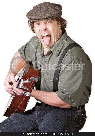 Guitarist Sticking Out His Tongue stock photo, Young Caucasian Guitarist sticking out his tongue by Scott Griessel