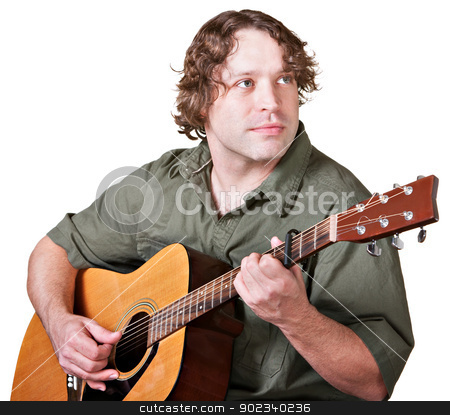 Relaxed Man Playing Guitar stock photo, Young guitarist playing music and looking over by Scott Griessel