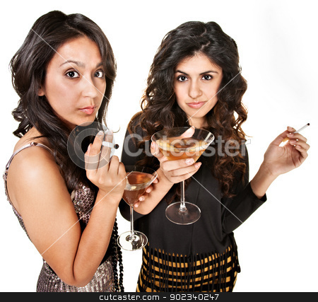 Young Women with Drinks stock photo, Young Hispanic club girls with cigarettes and alcohol by Scott Griessel