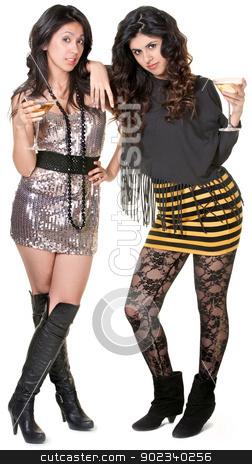 Two Hispanic Sisters Admiring Something stock photo, Cute Hispanic sisters in mini skirts admiring something by Scott Griessel