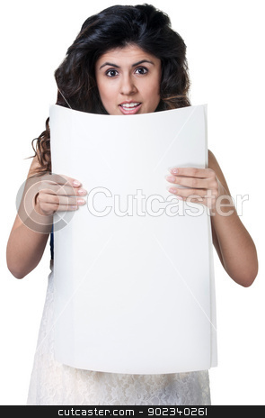 Startled Female With Sign stock photo, Startled Native American woman holding blank poster by Scott Griessel