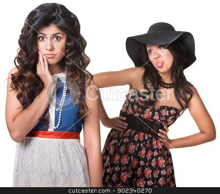 Woman Sticking Tongue Out at Friend stock photo, Young woman sticking her tongue out behind friend by Scott Griessel