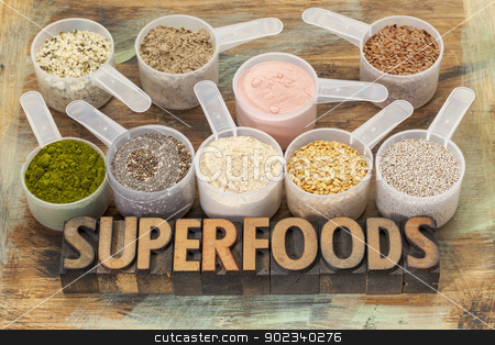 scoops of superfoods stock photo, superfoods word in letterpress wood type with plastic scoops of healthy seeds and powders (chia, flax, hemp, pomegranate fruit powder, wheatgrass, maca root) by Marek Uliasz