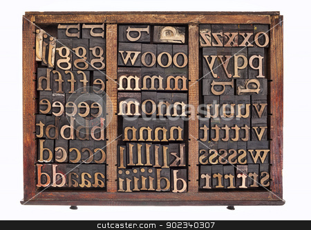 wood type in typesetter box stock photo, letterpress wood type printing blocks in old typesetter drawer isolated on white by Marek Uliasz