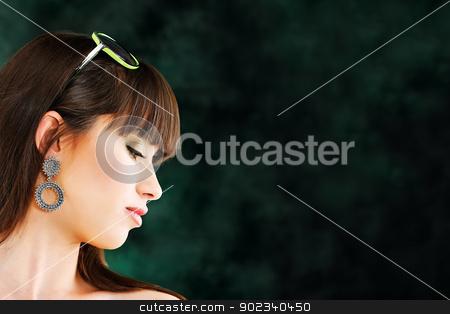 Pretty woman on dark background stock photo, Pretty young woman on dark background by iMarin