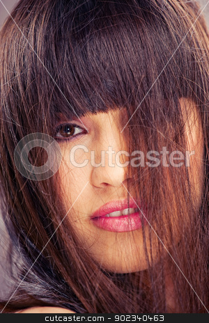 woman with long hair stock photo, Pretty brunette woman with long hair by iMarin