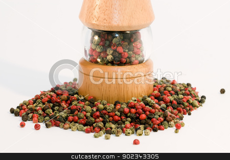 Mixed pepper with peppermill stock photo, Mixed pepper with electric peppermill by Mirko Pernjakovic