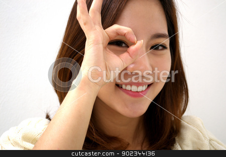 Looking Through stock photo, Woman looks through a round frame made by her hands  by blueperfume