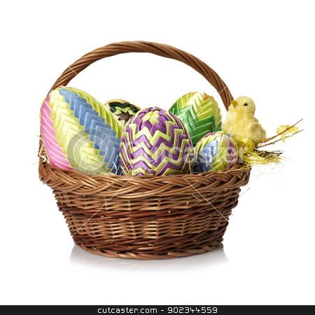 Easter eggs in wicker basket  stock photo, Easter eggs in wicker basket  on white background. by Filip Warulik