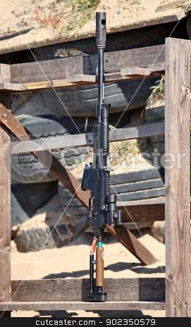 AK-47   stock photo, Kalashnikov rifle AK-47    under the cartridge of 12 gauge by mrivserg