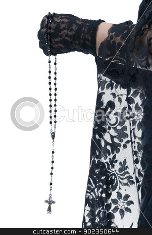 Rosary stock photo, close up of young woman holding rosary beads by Fernando Cervero Angulo