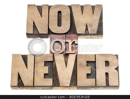 now or never in wood type stock photo, now or never - motivation phrase - isolated text in vintage letterpress wood type printing blocks by Marek Uliasz