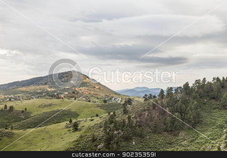 foothills of Rocky Mountains stock photo, hiking trail in Horsetooth Mountain Park, residential houses and Rocky Mountains, Fort Collins, Colorado - springtime scenery by Marek Uliasz