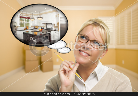 Woman in Empty Room with Thought Bubble of a New Kitchen Design stock photo, Attractive Woman in Empty Room with Thought Bubble of a New Kitchen Design. by Andy Dean