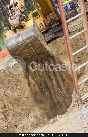 Excavator Tractor Digging A Trench stock photo, Working Excavator Tractor Digging A Trench. by Andy Dean