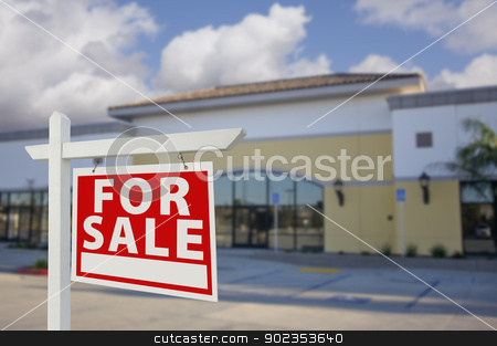 Vacant Retail Building with For Sale Real Estate Sign stock photo, Vacant Retail Building with For Sale Real Estate Sign in Front. by Andy Dean
