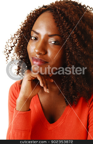 Closeup of teen girl. stock photo, Closeup portrait of a lovely black teenager, smiling into the camera, with one hand under her shin for white background.  by Horst Petzold