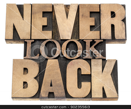 never look back in wood type stock photo, never look back phrase - isolated text in vintage letterpress wood type printing blocks, a variety of fonts by Marek Uliasz