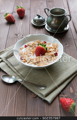 Breakfast cereals with milk and strawberries stock photo, Bowl with rice flakes and strawberry for nourishing breakfast by Giordano Aita