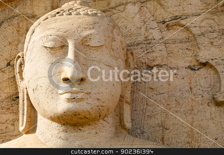 Buddha face on yellow stone stock photo, Buddha face on yellow stone background, Polonnaruwa, Sri Lanka  by Iryna Rasko