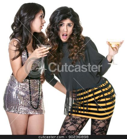 Club Girls Gossiping stock photo, Surprised club girl listening to friend telling secrets by Scott Griessel