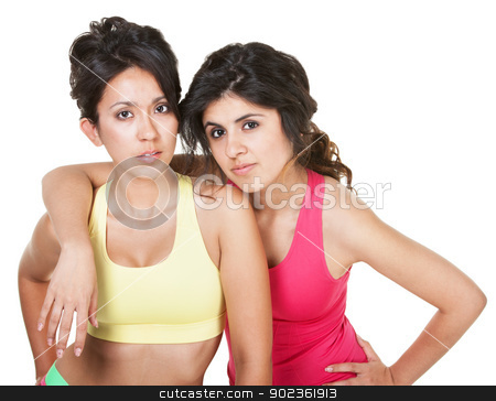 Serious Women in Fitness Clothes stock photo, Serious pretty female friends it fitness clothing over white by Scott Griessel