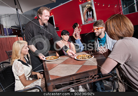 Hipsters Eat at Mobile Cafe stock photo, Hipster group served pizza by mobile cafe chef by Scott Griessel