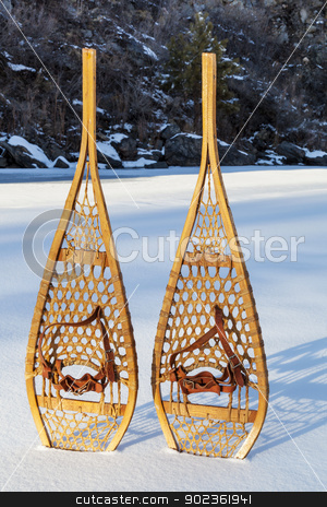 vintage Huron snowshoes stock photo, vintage wooden Huron snowshoes with leather binding in snow by Marek Uliasz