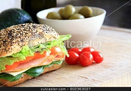 Sandwich stock photo, Image of a tasty sandwich with ham, lettuce and olives by zuzanaderek