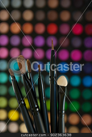 Cosmetics stock photo, Cosmetics Brushes on a colorful make up palette background by Javier Correa