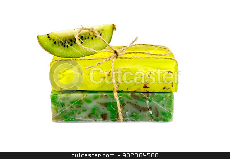 Soap homemade with a slice of kiwi stock photo, Two green homemade soap with a slice of kiwi isolated on white background by rezkrr